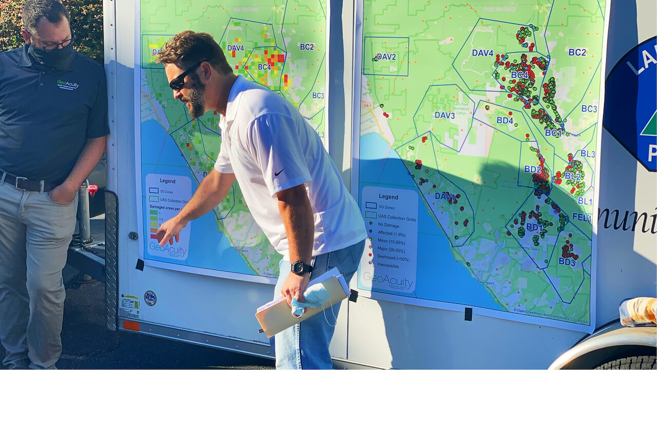 Man pointing to a large map of the destruction of the CZU complex fire