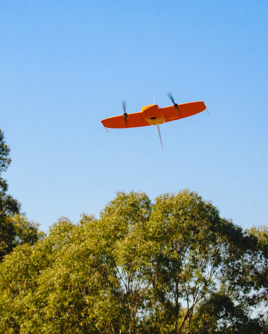 WingtraOne flying over trees