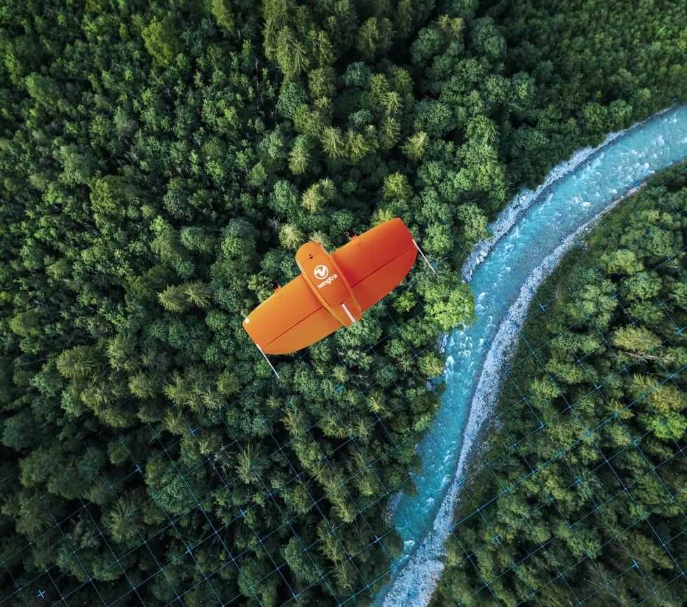 VTOL mapping drone WingtraOne flying over a forest