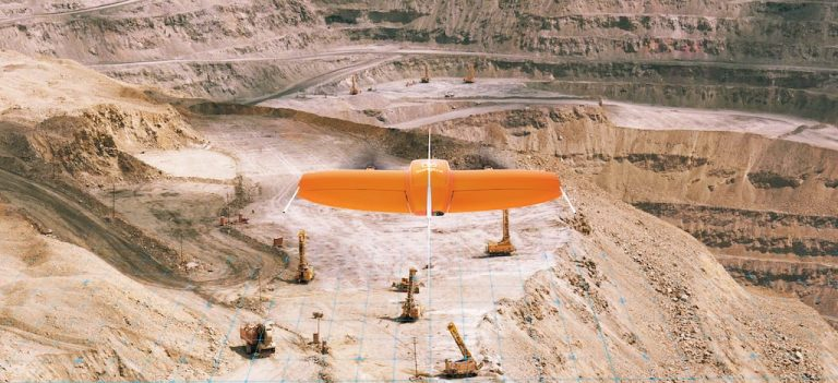 VTOL fixed-wing drone mapping a quarry